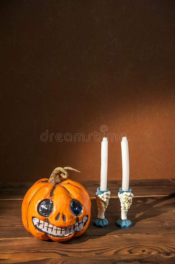 Halloween holiday concept. Pumpkin with a face. Burning and extinguished candles. Background for text with pumpkin and smoke. Hall. Oween pumpkin head jack royalty free stock photo