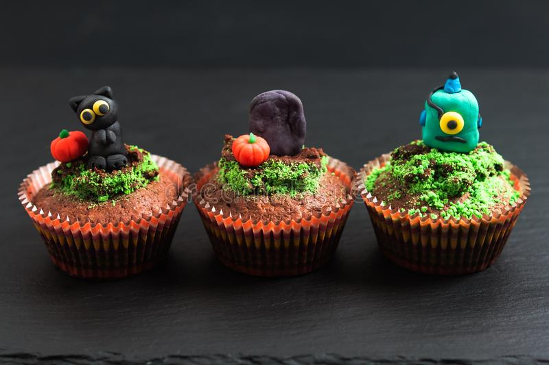 Halloween Holiday food colorful fancy brownies cupcake with fond. Ant decorate stock photo