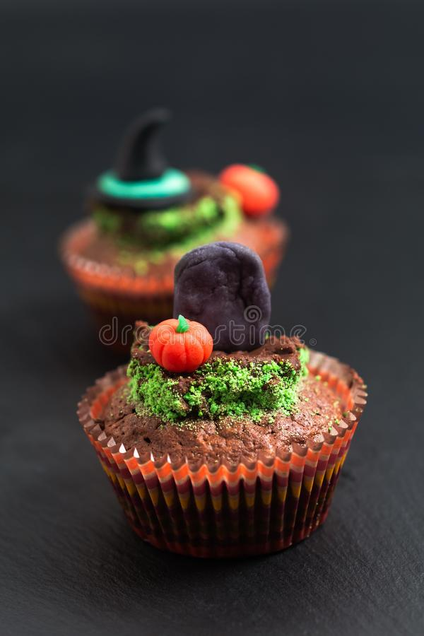 Halloween Holiday food colorful fancy brownies cupcake with gravestones and pumpkin fondant decorate stock photography