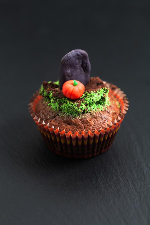 Halloween Holiday food colorful fancy brownies cupcake with gravestones and pumpkin fondant decorate royalty free stock images