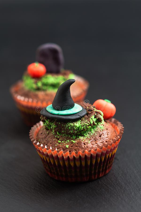 Halloween Holiday food colorful fancy brownies cupcake with witch and pumpkin fondant decorate royalty free stock photography