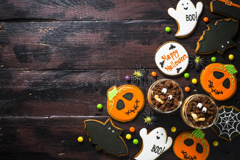Halloween holiday food - Gingerbread Cookies and pumpkin dessert royalty free stock photography