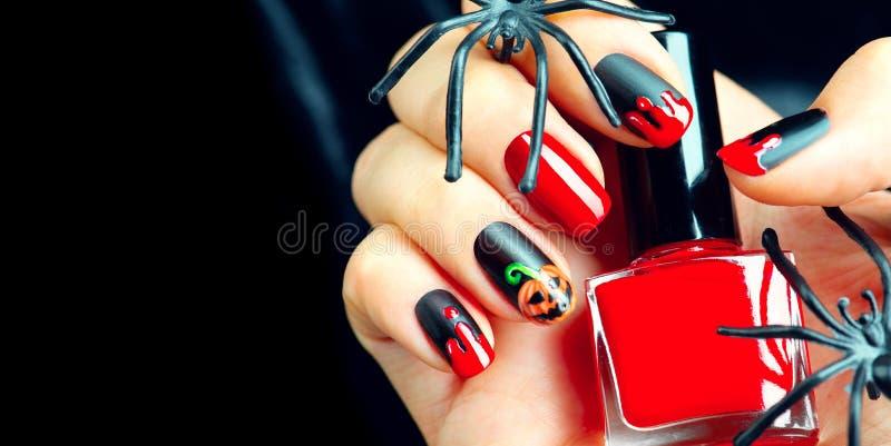 Halloween holiday manicure design ideas stock photos