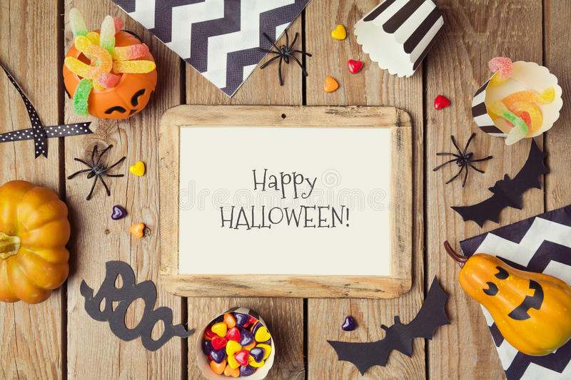 Halloween holiday poster mock up template with pumpkin and candy. View from above royalty free stock image