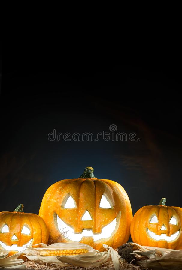 Halloween holiday poster with pumpkin Jack O´lantern. Copy space. Black background royalty free stock images