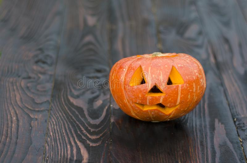 Halloween holiday with pumpkin on a dark wooden background. Halloween holiday with pumpkin on a dark wooden background. jack head. stock images
