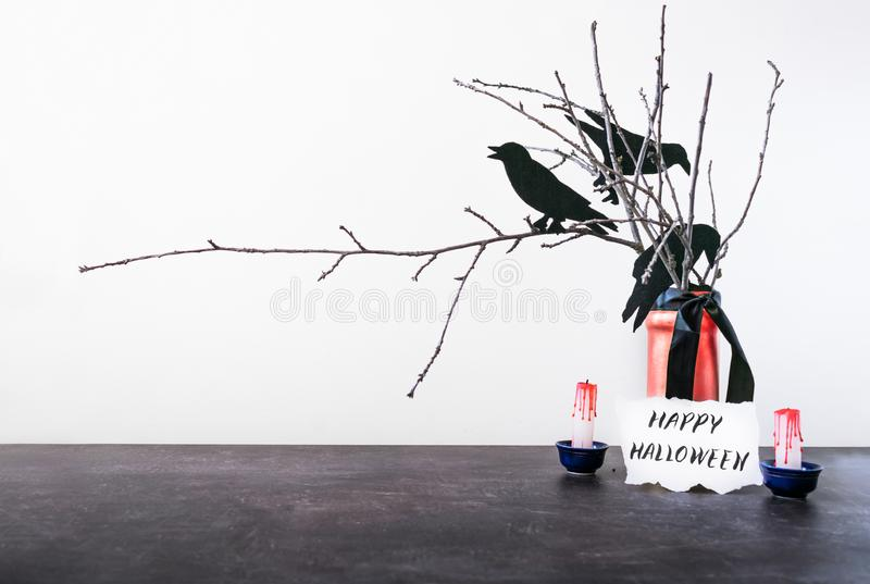 Halloween home decorations with dry branches, crows, vase, blood royalty free stock photos