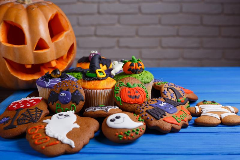 Halloween homemade gingerbread cookies and cupcakes background w royalty free stock photography