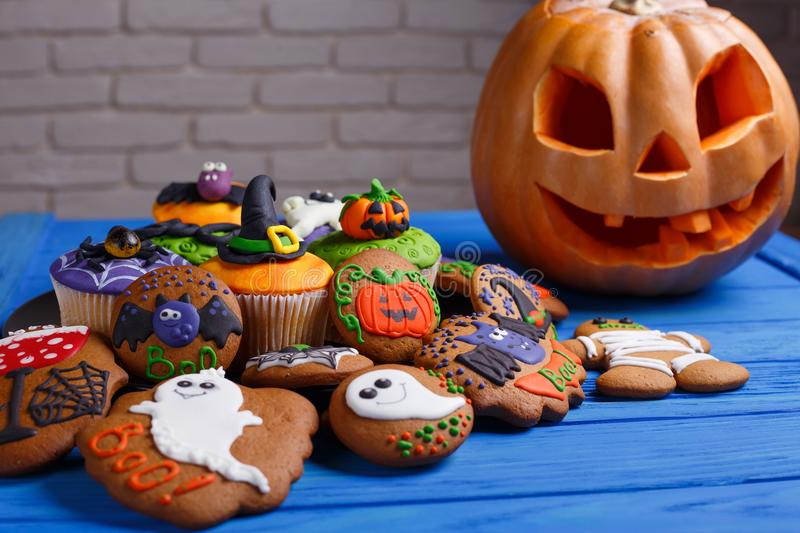 Halloween homemade gingerbread cookies and cupcakes background w royalty free stock photo
