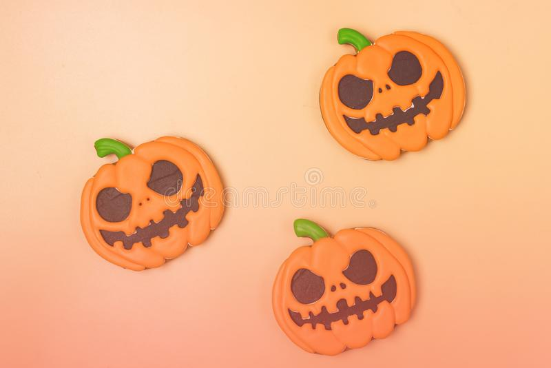 Halloween Homemade Gingerbread Cookies in Shape of Angry Pumpkin Three Halloween Cookies on Yellow Background Toned Horizontal Top. View stock images