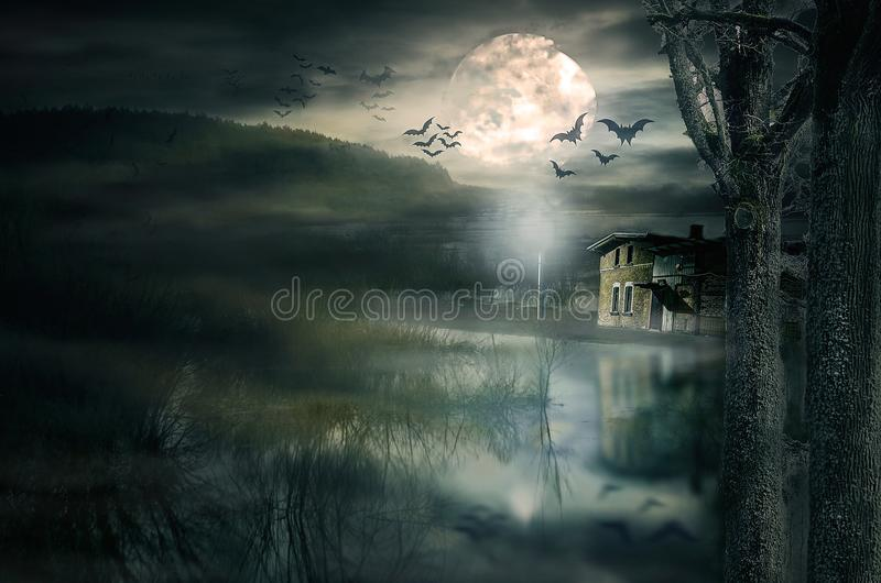Halloween house with Moon and bats. Old ruined sinister house by night. Haunted house with dark scary horror atmosphere stock photos