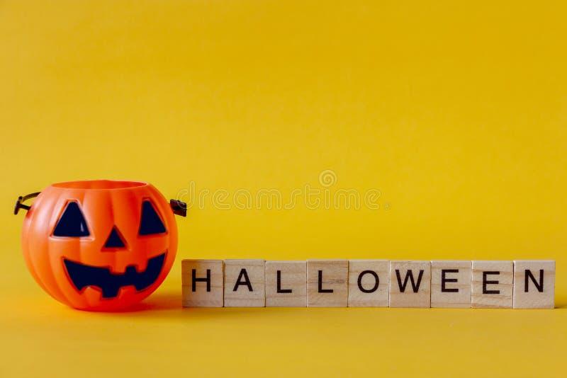 Halloween Jack o Lantern bucket with on yellow background royalty free stock image