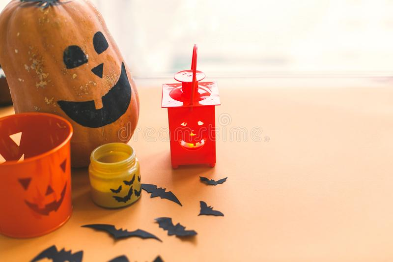 Halloween jack o lantern, pumpkin, candle, black bats and ghost paper decorations on yellow background.Trick or treat concept. stock photography