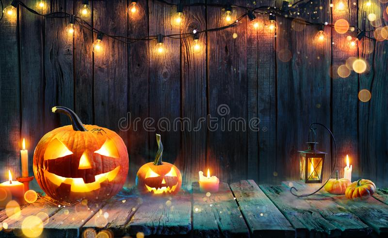 Halloween - Jack O` Lanterns - Candles And String Lights royalty free stock photography
