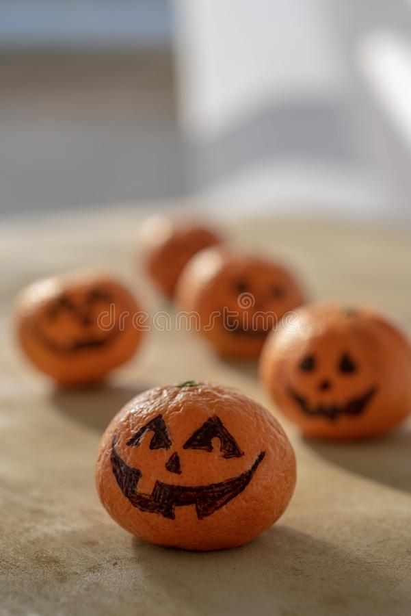 Halloween Jack o Lanterns healthy trick or treat tangerines stock photos