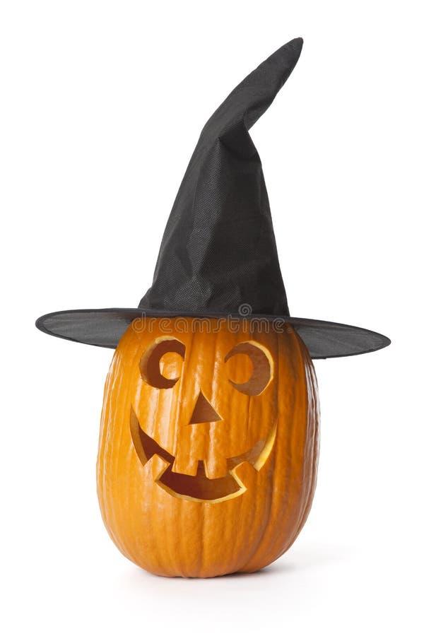 Halloween-Kürbis mit schwarzem Hut auf weißem backgro stockfotos