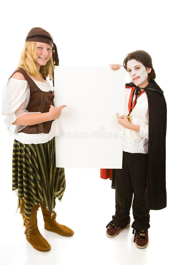 Halloween Kids Holding Sign Stock Photo