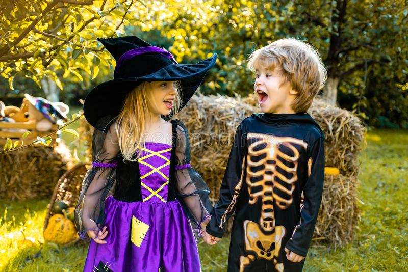 Halloween kids holidays concept. Halloween party with children wearing Halloween costumes. Happy children with skeleton royalty free stock image