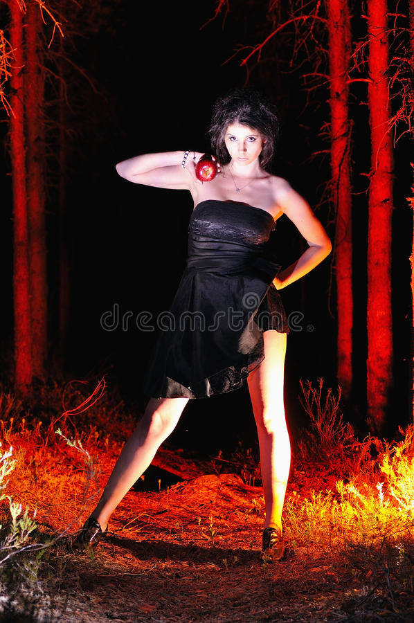 Free Halloween Looking Witch In A Dark With Apple Stock Photos - 32988763