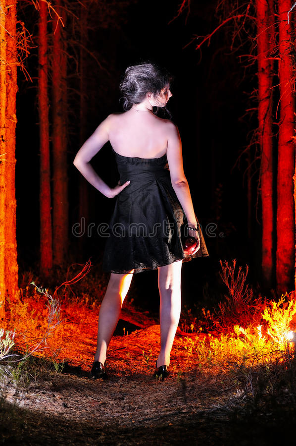 Free Halloween Looking Witch In A Dark With Apple Royalty Free Stock Image - 32988816
