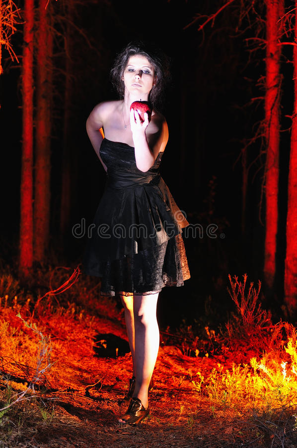 Free Halloween Looking Witch In A Dark With Apple Royalty Free Stock Photography - 32988827