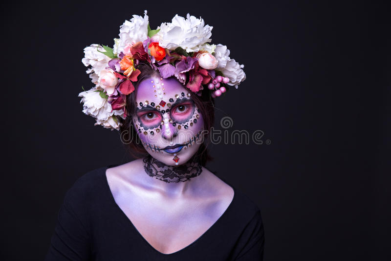 Halloween Makeup with Rhinestones and Wreath of Flowers stock photo