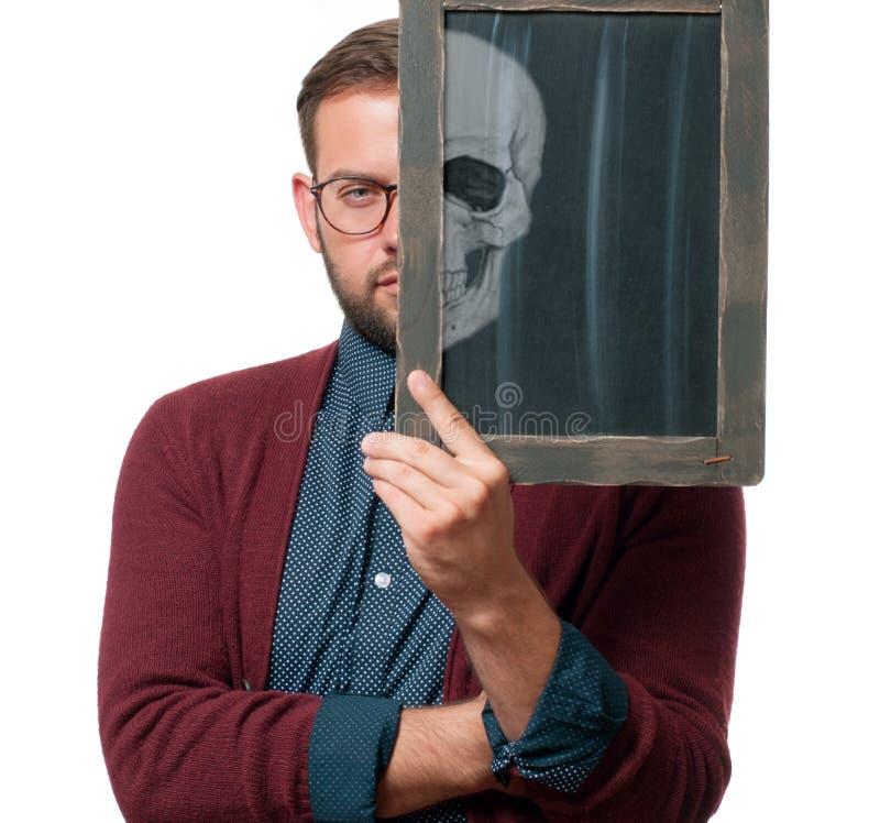 Half face portrait. Halloween concept. Man skull royalty free stock photo