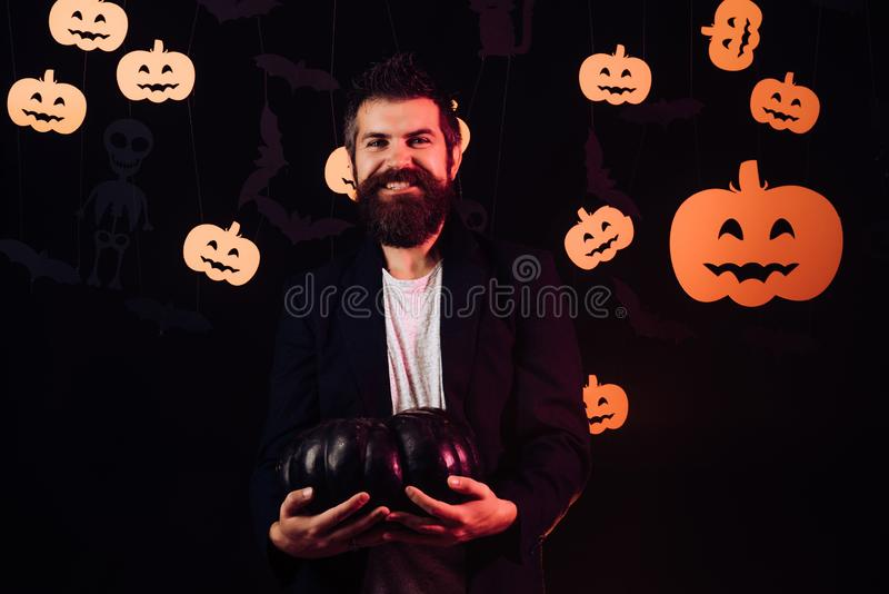 Halloween Man funny faces. Background decorated for Halloween. Jack-o-lanterns. Happy Halloween Quotes and Sayings. Magic pumpkin royalty free stock photography