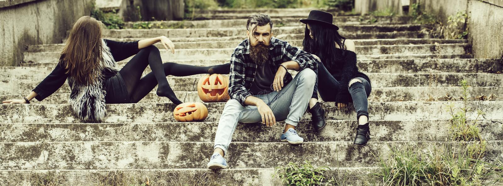 Halloween man and girls with pumpkin royalty free stock photo