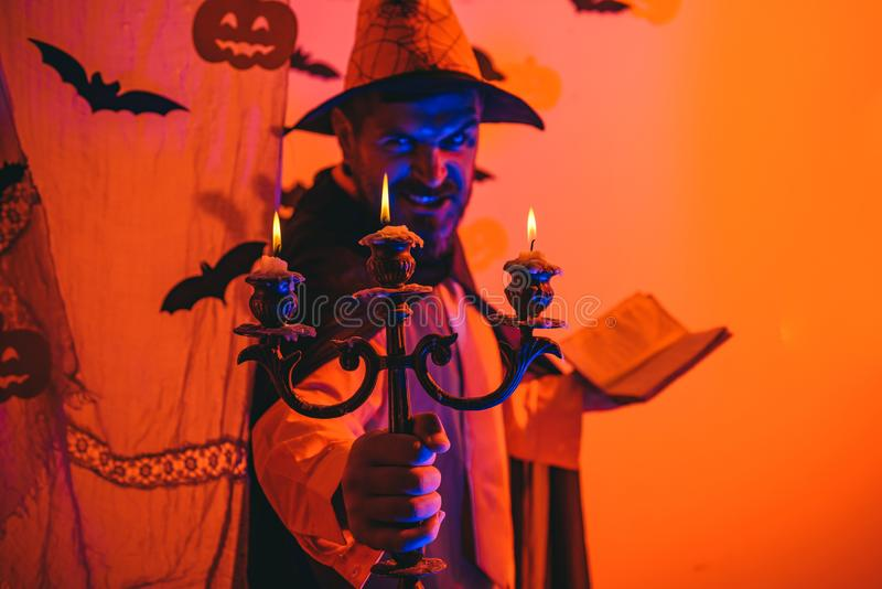 Halloween man with pumpkin in darkness. Happy hipster with bloody beard with pumpkins. Halloween, holidays celebration. stock images