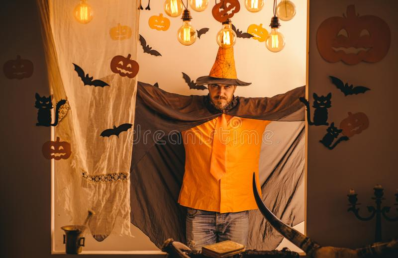Halloween man with pumpkin in darkness. Magic, enchantment, witchcraft. stock images