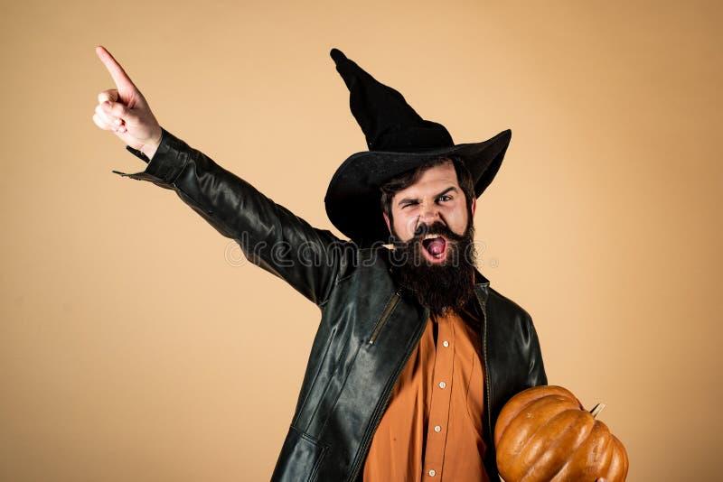 Halloween man with pumpkin - Holidays celebration concept. Halloween beaded man hold pumpkin - portrait. Happy Halloween stock photography