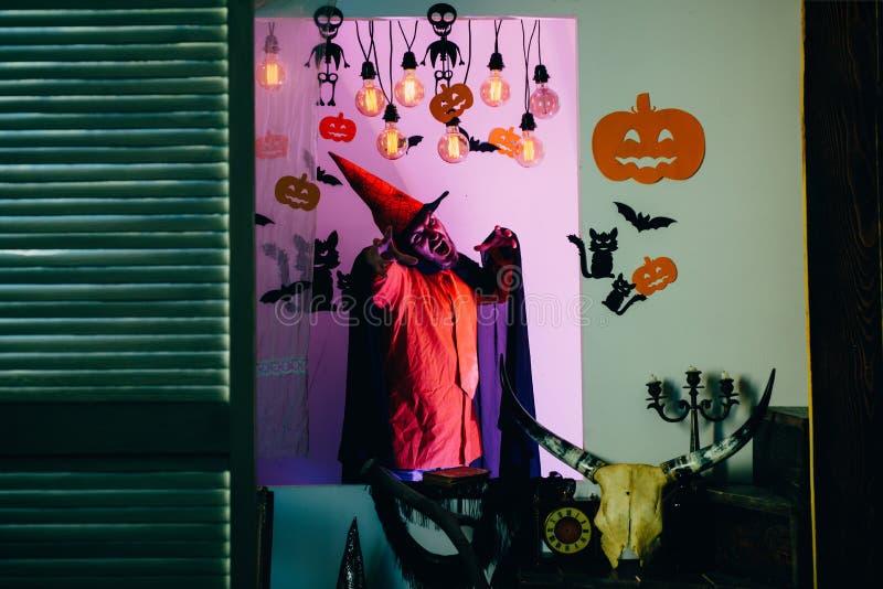 Halloween man with smile on dark background. Halloween man with pumpkin in darkness. stock image