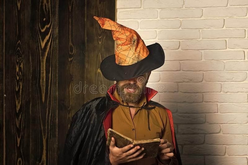 Halloween man in witch hat and cloak royalty free stock photos