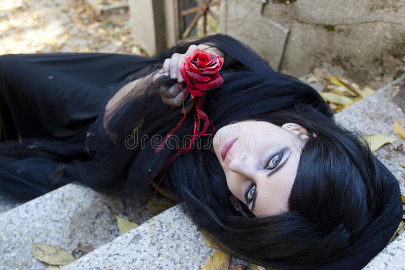 Halloween Misterious Dressed Gothic Woman. Misterious woman dressed in black gothic dress royalty free stock photos