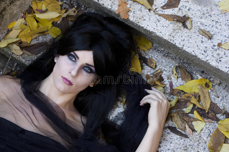 Halloween Misterious Dressed Gothic Woman. Misterious woman dressed in black gothic dress stock photography