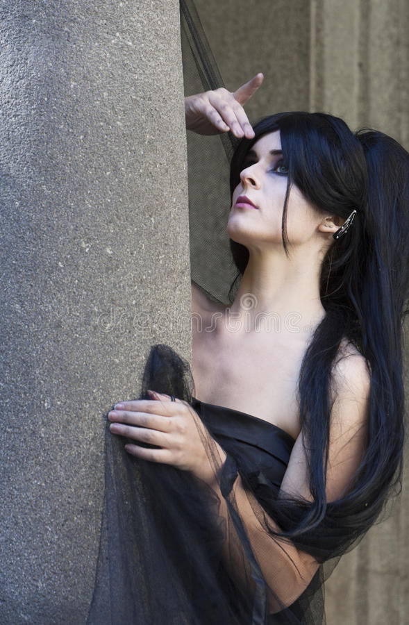 Halloween Misterious Dressed Gothic Woman. Misterious woman dressed in black gothic dress stock images