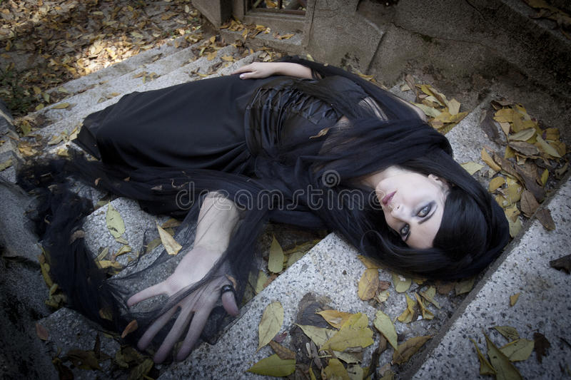 Halloween Misterious Dressed Gothic Woman. Misterious woman dressed in black gothic dress stock photo