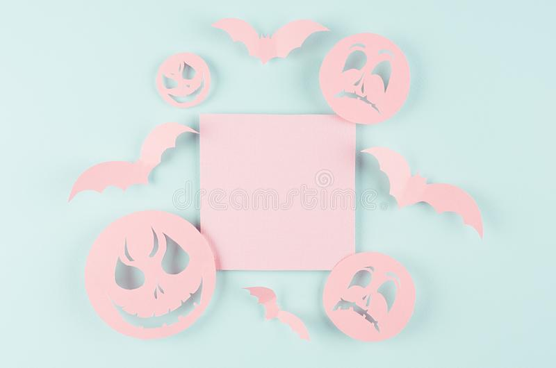 Halloween mock up with pink blank sale label, bats, spooky faces emoji of cut paper on pastel trendy mint blue background. stock image