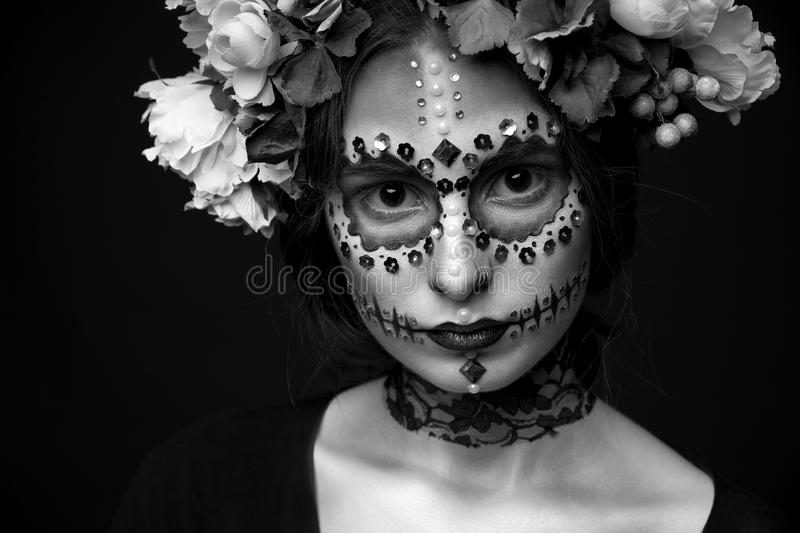 Halloween Model close-up with Rhinestones and Wreath of Flowers stock photo