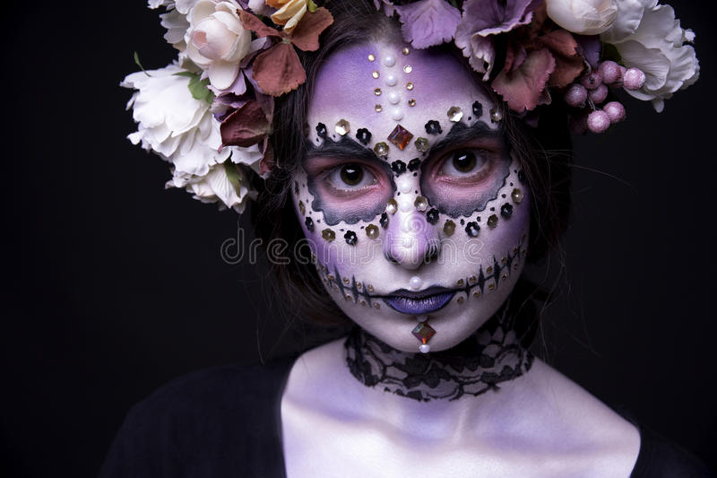 Halloween Model close-up with Rhinestones and Wreath of Flowers stock photos
