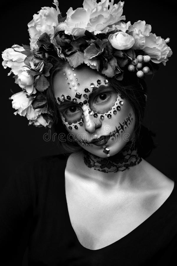 Halloween Model with Rhinestones and Wreath of Flowers royalty free stock image