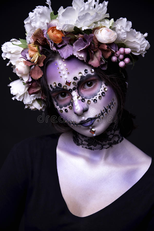 Halloween Model with Rhinestones and Wreath of Flowers royalty free stock photography