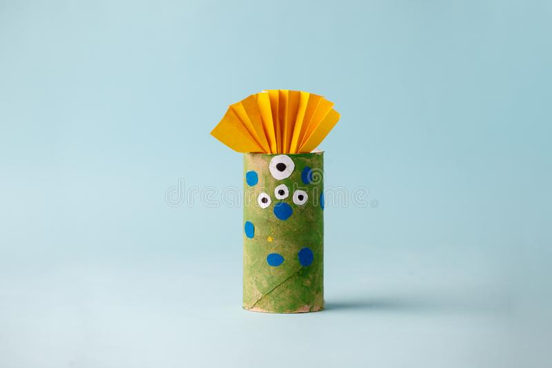 Halloween monster on blue for Halloween concept background. Paper crafts, DIY. Handcraft creative idea fron toilet tube, recycle. Concept, copy space royalty free stock image