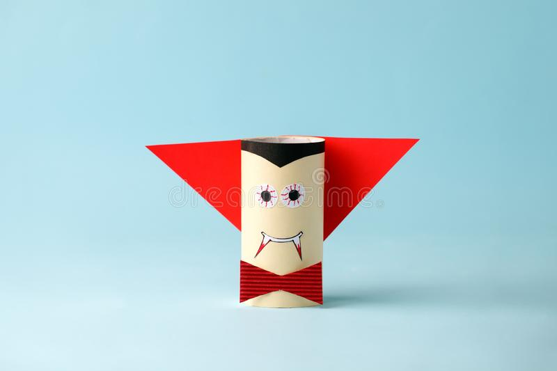Halloween monster vampire on blue for Halloween concept background. Paper crafts, DIY. Handcraft creative idea fron toilet tube, royalty free stock photography