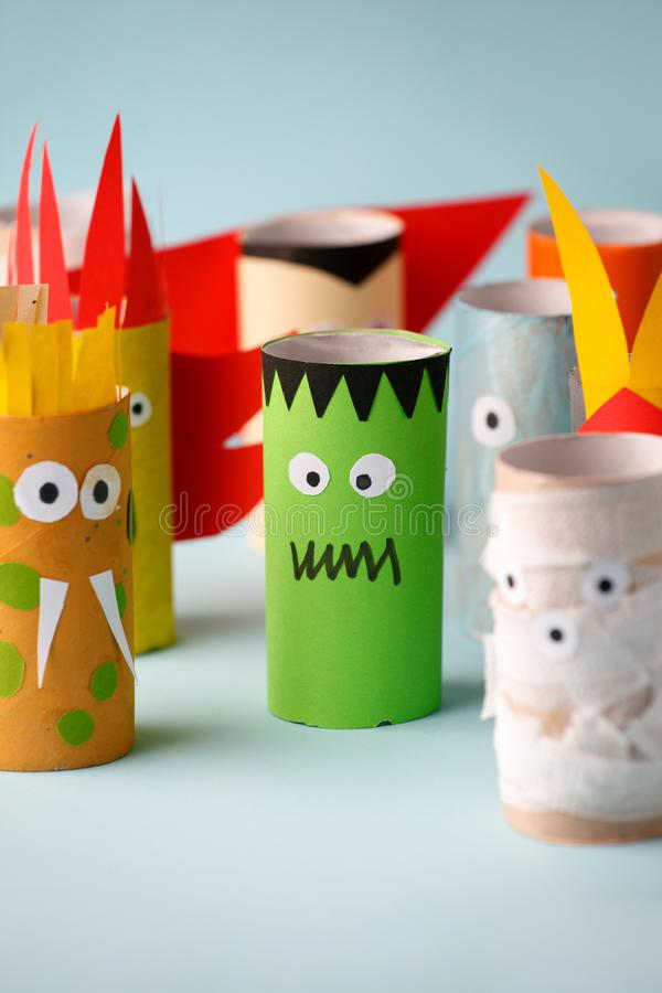 Halloween monsters doll from toilet paper tube. Creative DIY for kids. Home decor for party. Paper handie crafts inspiration. Eco-. Friendly reuse recycle idea stock images