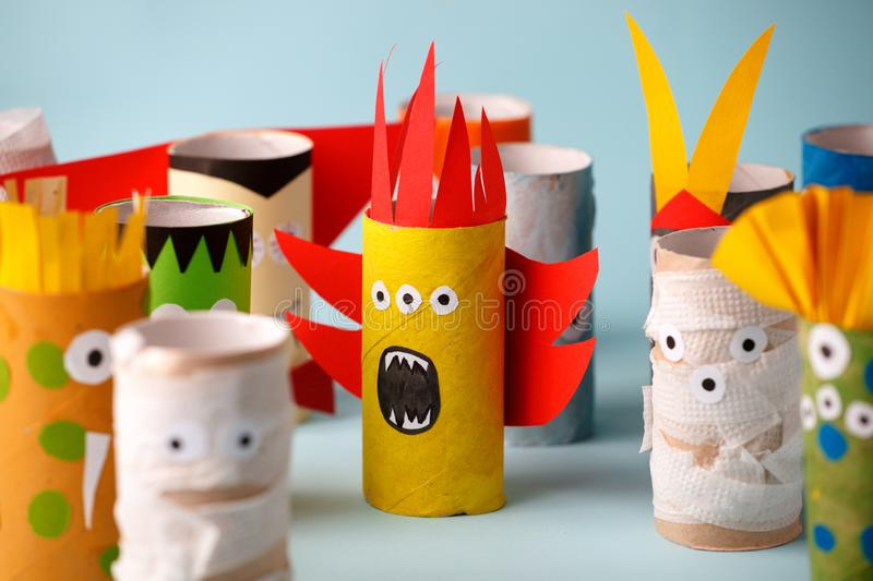 Halloween monsters doll from toilet paper tube. Creative DIY for kids. Home decor for party. Paper handie crafts inspiration. Eco-. Friendly reuse recycle idea stock photography
