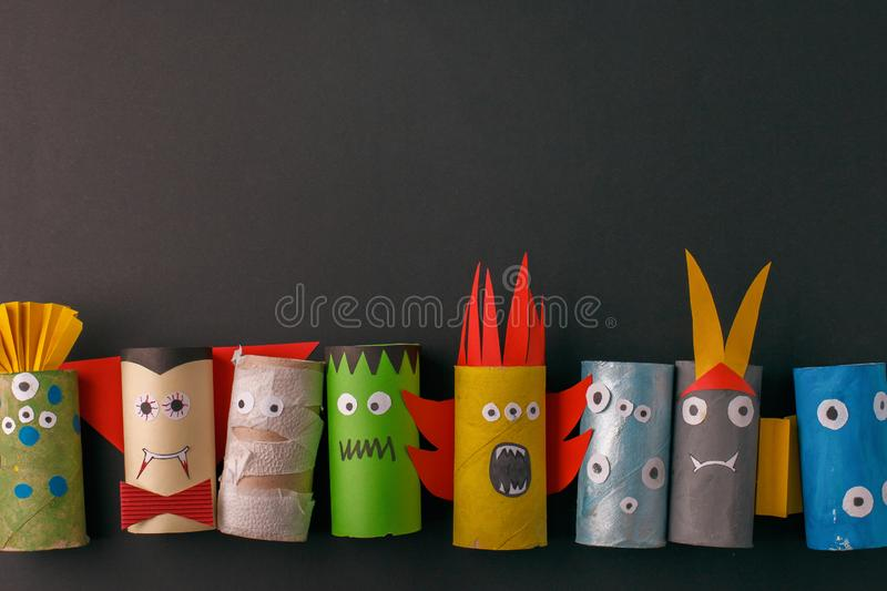 Halloween monsters doll from toilet paper tube roll. Creative DIY for kids. Home decor for party. Paper handie crafts inspiration. Eco-friendly reuse recycle royalty free stock image