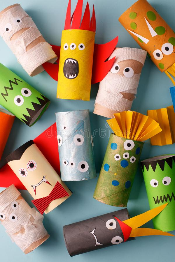 Halloween monsters doll from toilet paper tube roll. Creative DIY for kids. Home decor for party. Paper handie crafts inspiration. Eco-friendly reuse recycle stock photo