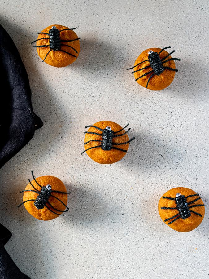 Halloween muffins and spiders, party baking ideas for kids, scary, spooky royalty free stock images
